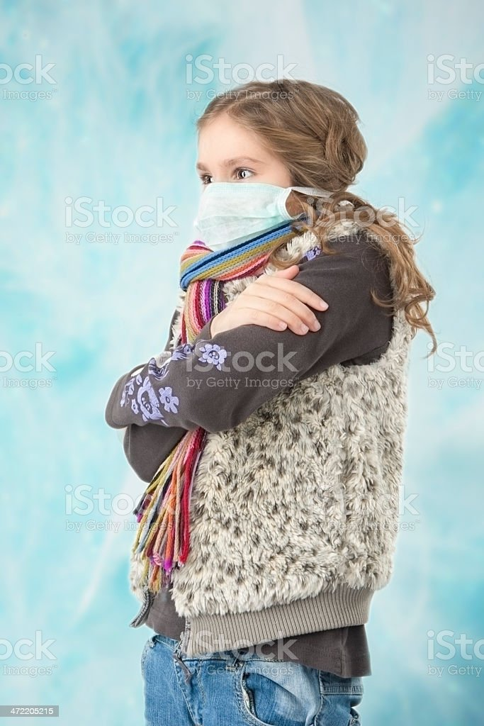 Little girl with facial mask stock photo