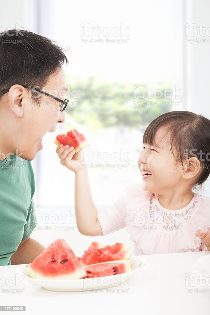 little girl with father eating fruits royalty-free stock photo