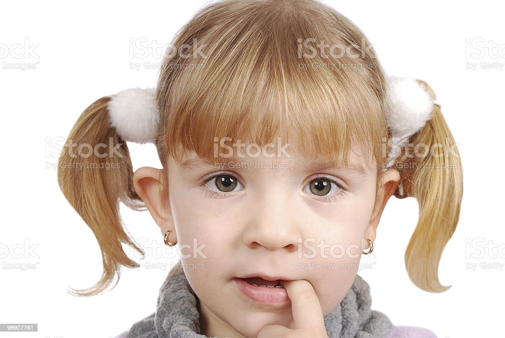 little girl with finger in mouth royalty-free stock photo