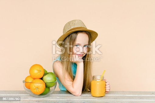 istock Little girl with fruits. 867386760