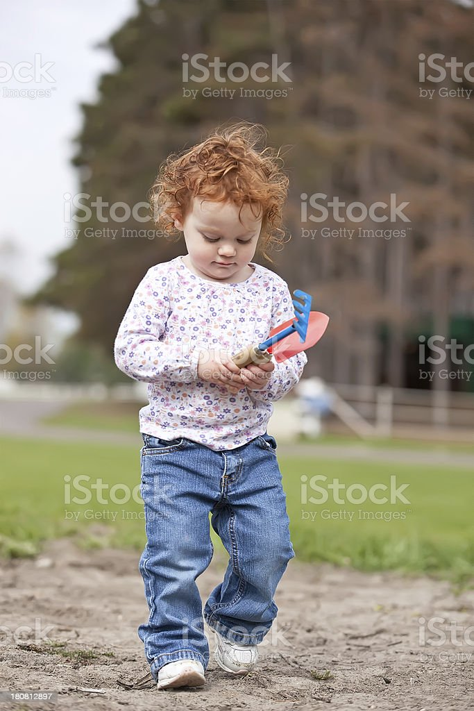 Little Girl with Garden Tools royalty-free stock photo