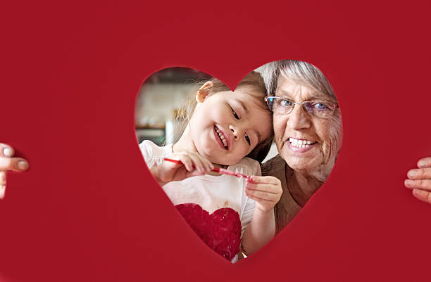 little girl with grandmother - senior valentine stock photos and pictures