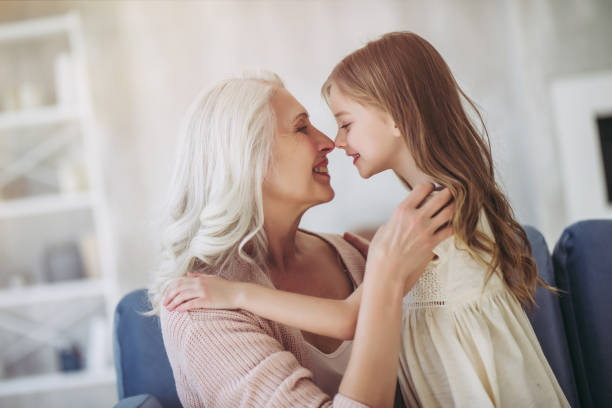 little girl with grandmother - granddaughter and grandmother stock photos and pictures