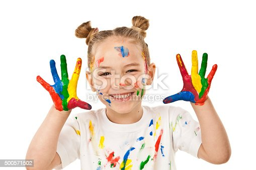 istock Little girl with hands and face covered with paint 500571502