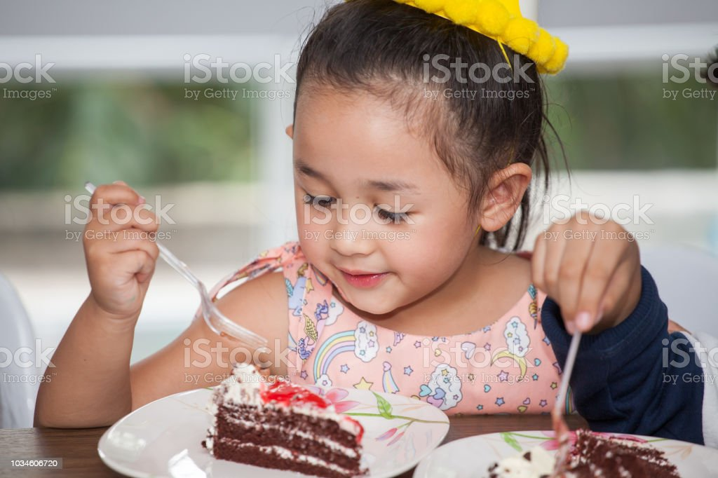 Magnificent Little Girl With Hat Eating Birthday Cake Stock Photo Download Funny Birthday Cards Online Inifofree Goldxyz