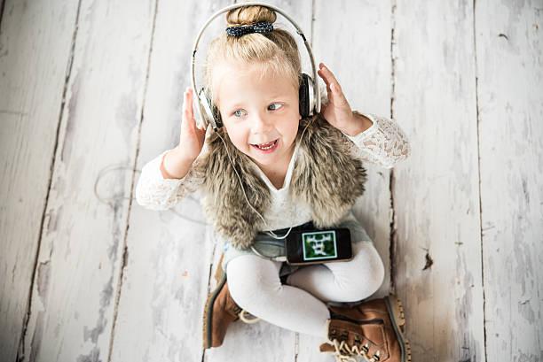 Little girl with headphones stock photo