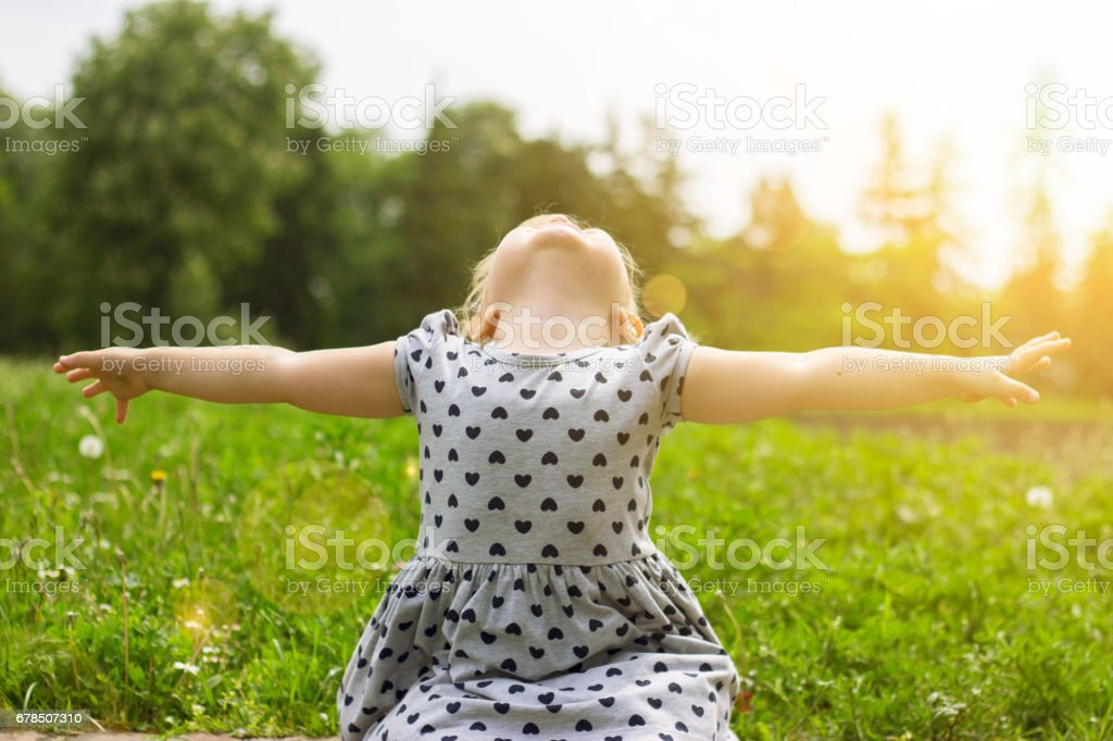 Little girl with her arms open, life concept stock photo