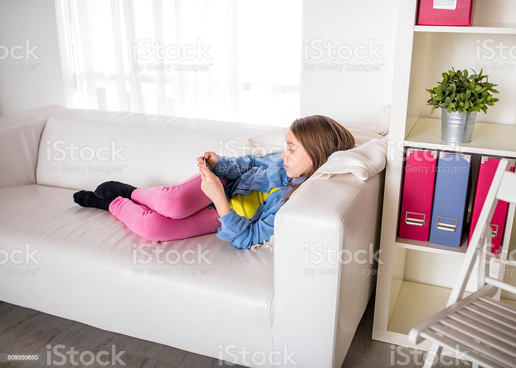 Little Girl with her digital tablet stock photo