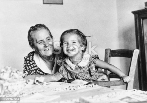 Female child with her Grandmother in 1949.