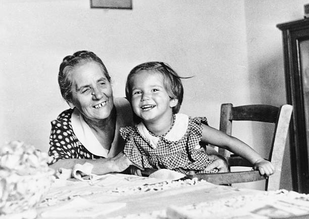 little girl with her grandmother in 1949 - 1940s style stock photos and pictures