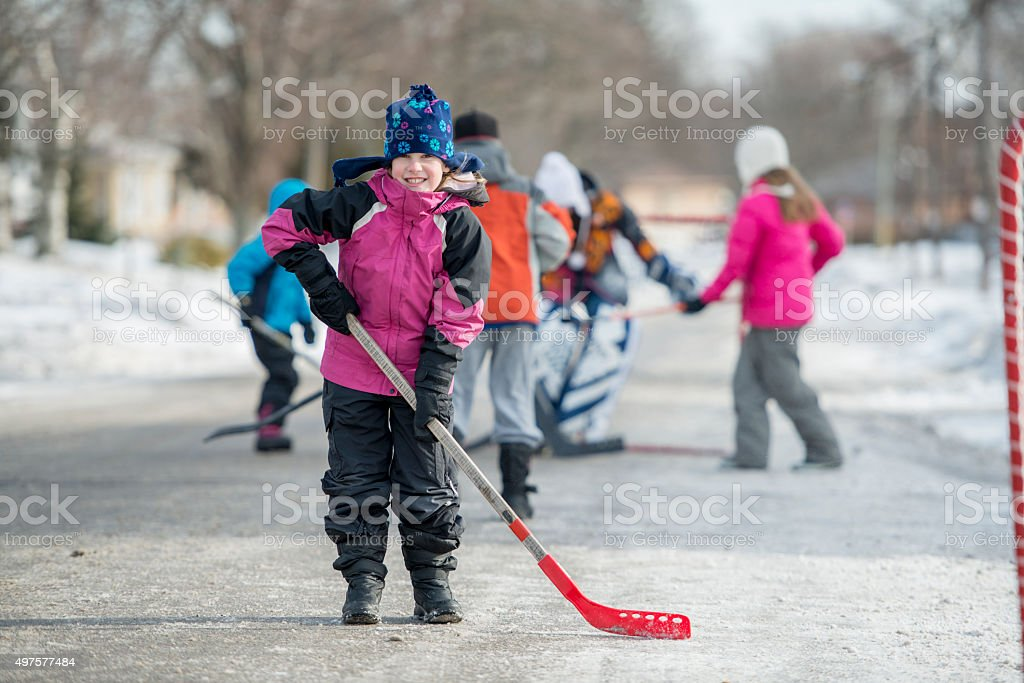 Little Girl With Her Hockey Stick stock photo