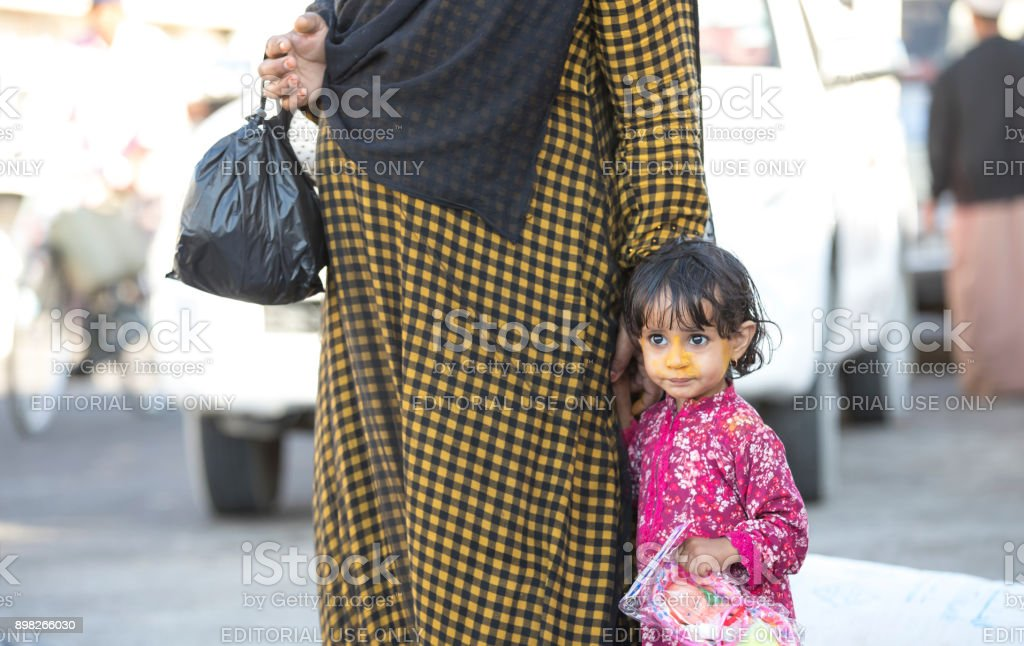 little girl with her mother at a market stock photo