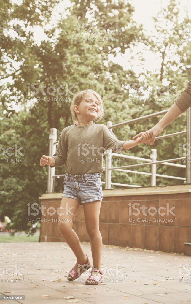 Little girl with her mother walking outdoor. royalty-free stock photo