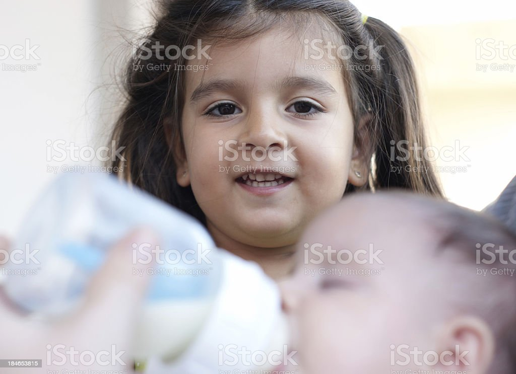 little girl with her sister royalty-free stock photo