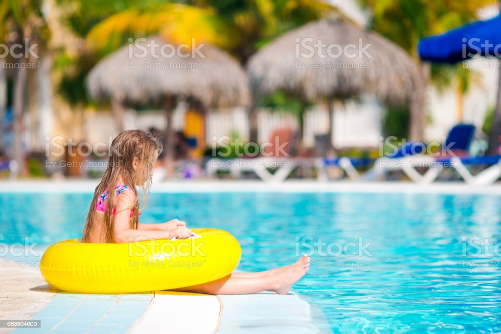 Little Girl With Inflatable Rubber Circle In Swimming Pool Stock Photo -  Download Image Now