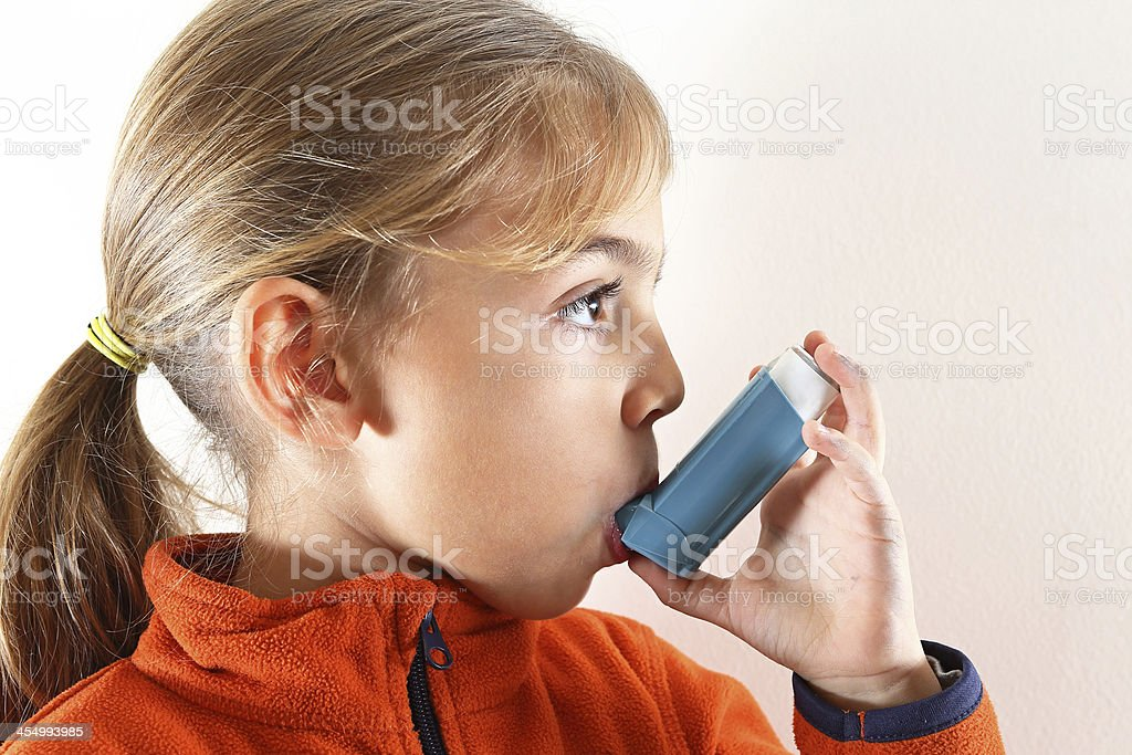 Little Girl with Inhaler stock photo