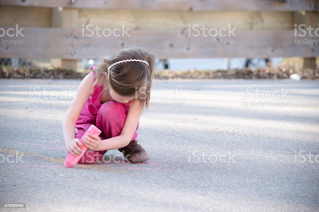 Little girl with jumbo chalk stock photo