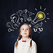 istock Little girl with lightbulb portrait. Ideas, doubt and Hope concept 1019220054