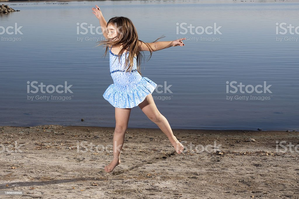 Little Girl with Long Hair Dancing on Beach royalty-free stock photo