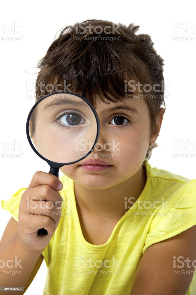 little girl with magnifier stock photo