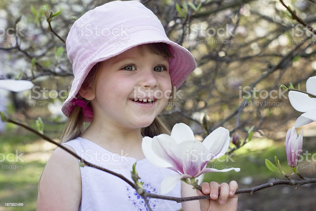little girl with magnolia flower royalty-free stock photo