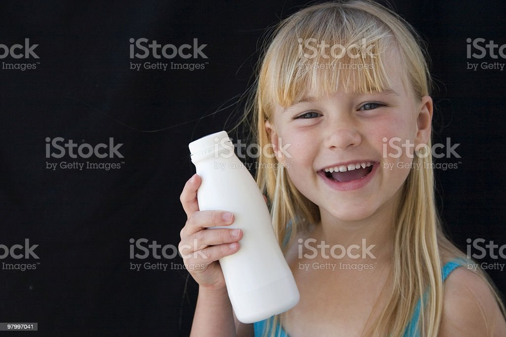 Little girl with milk royalty free stockfoto