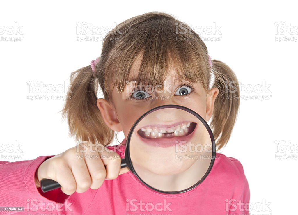 little girl with missing baby tooth stock photo