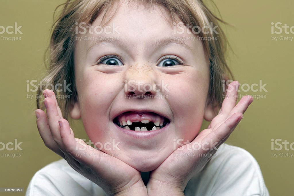Little girl with missing teeth making a scary face royalty-free stock photo