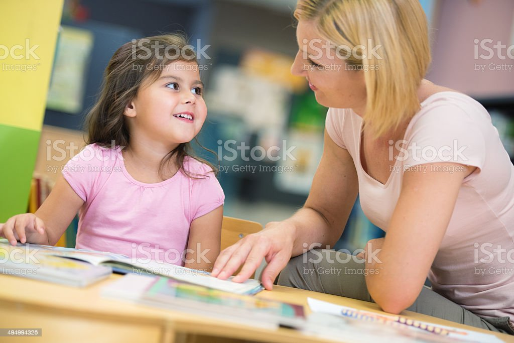 Little girl with mother in library stock photo