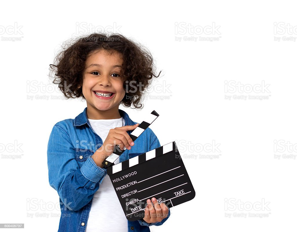 Little girl with movie slate stock photo