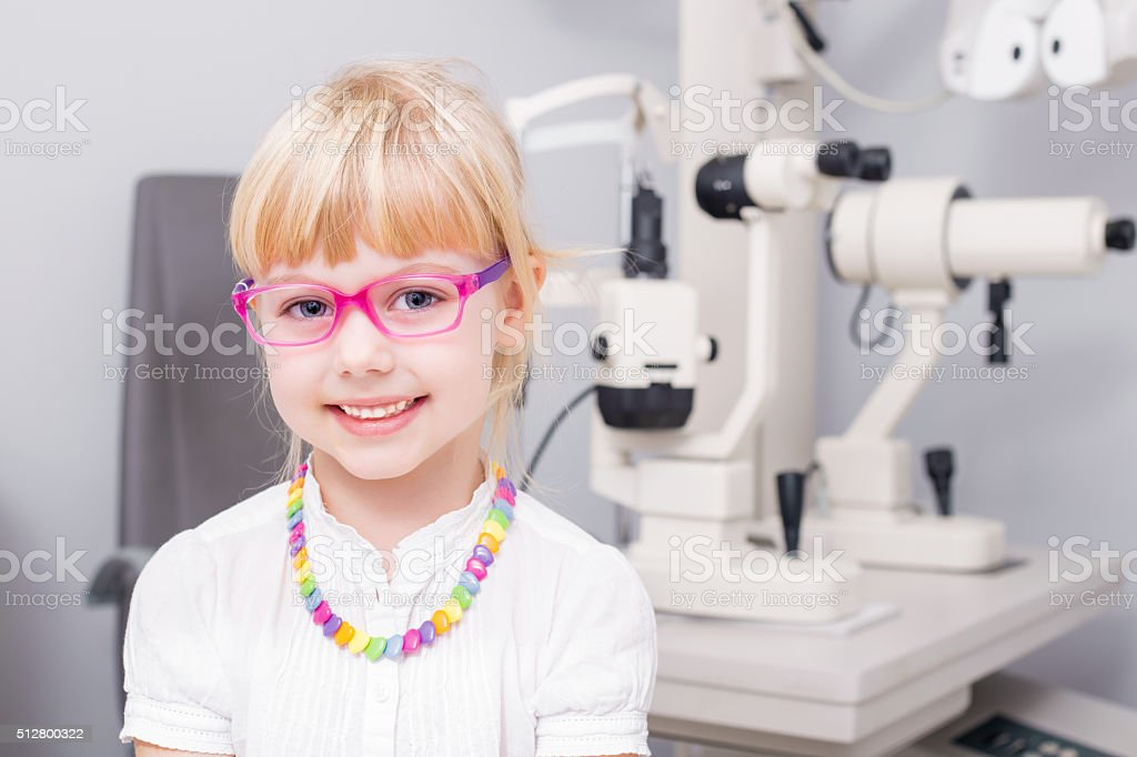 Little girl with optic glasses stock photo
