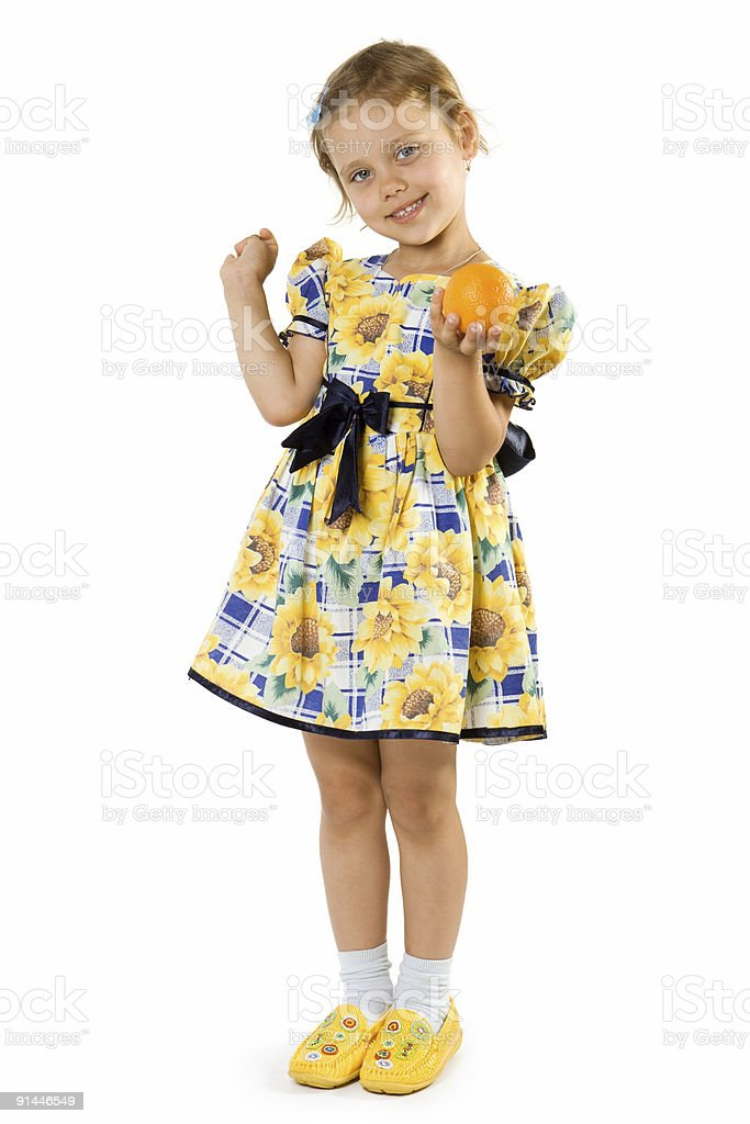 Little girl with orange. royalty-free stock photo