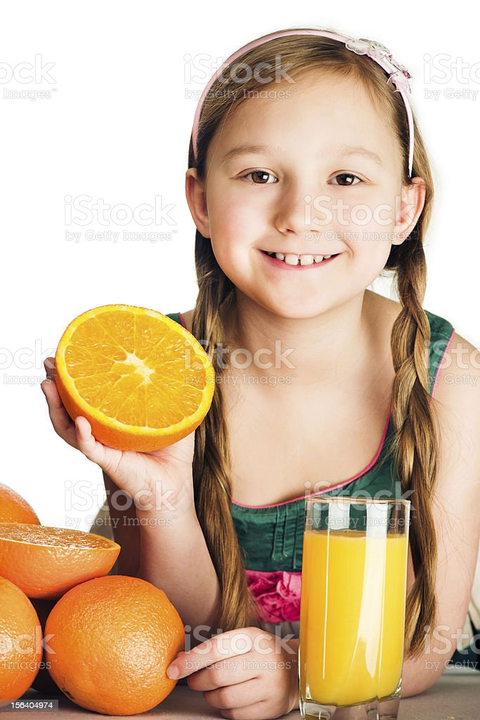Little girl with oranges royalty-free stock photo