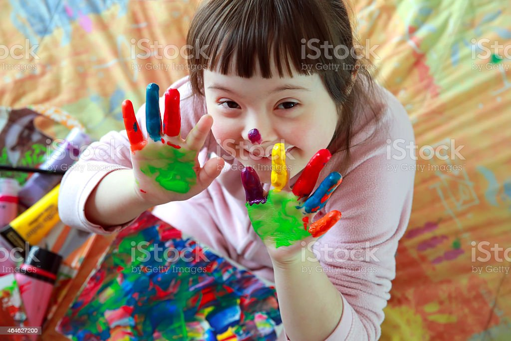 little girl with painted hands stock photo