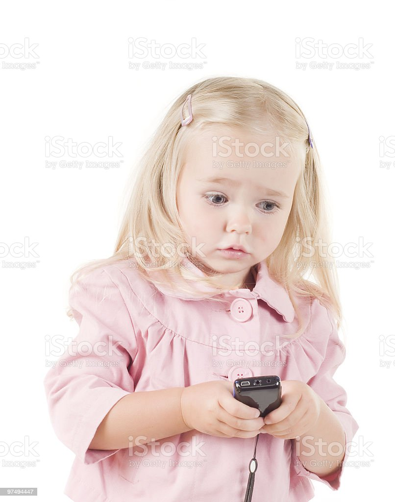 Little girl with phone royalty-free stock photo