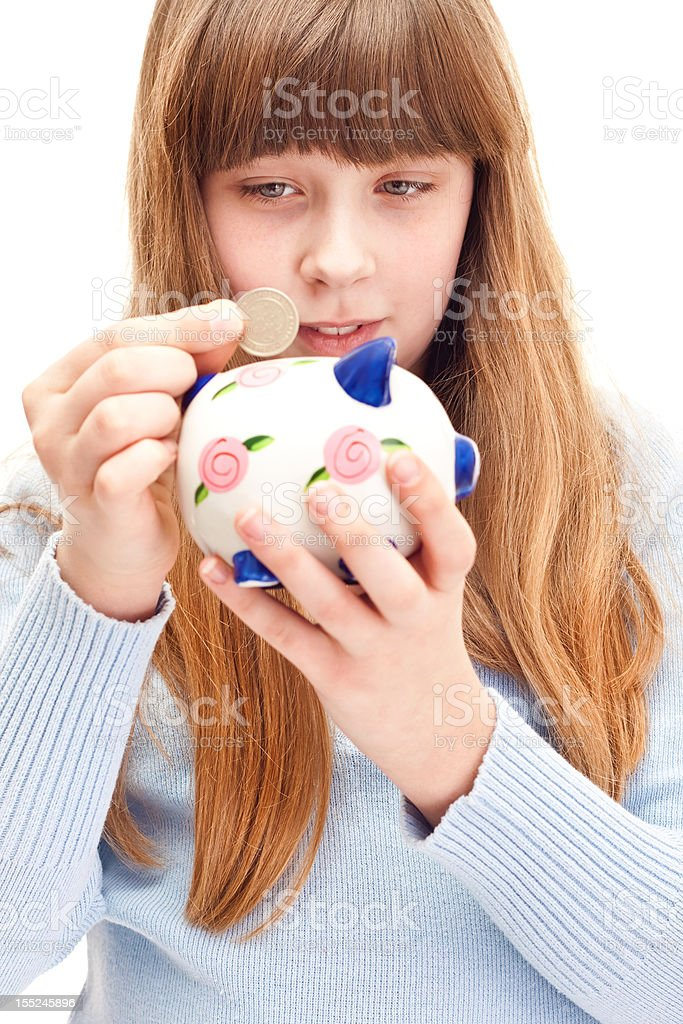 little girl with piggy bank royalty-free stock photo
