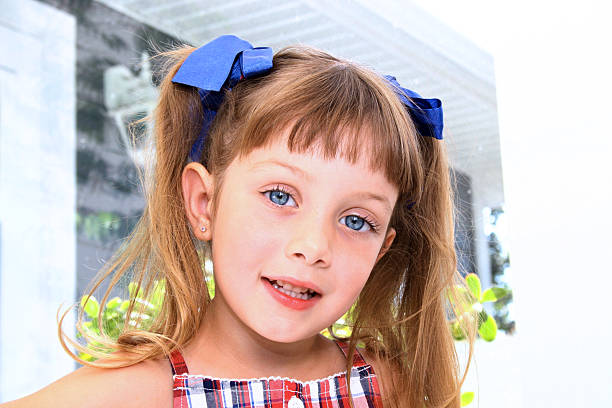 Little girl with pigtails stock photo