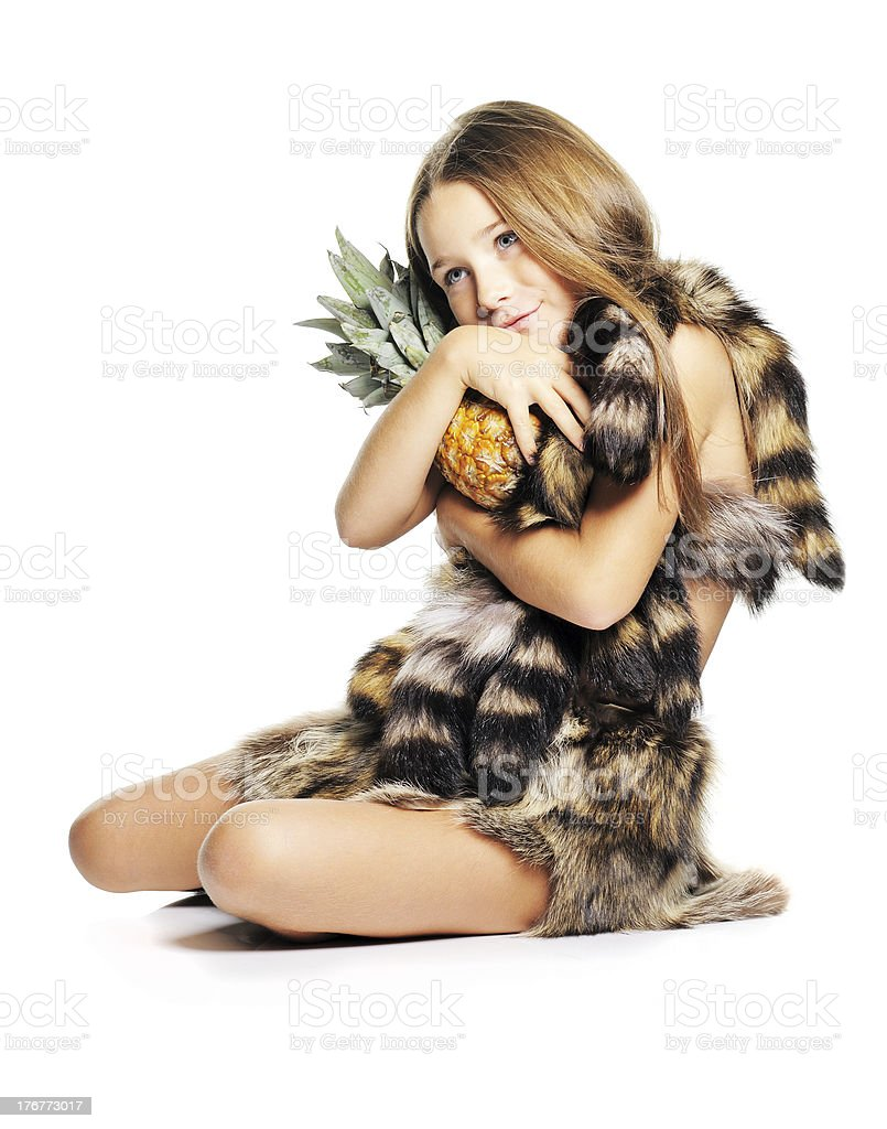 Little girl with pineapple royalty-free stock photo