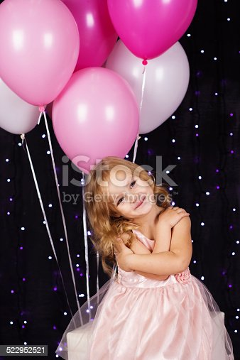 istock Little girl with pink balloons 522952521