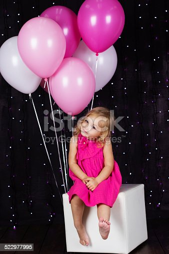 502281614 istock photo Little girl with pink balloons 522977995