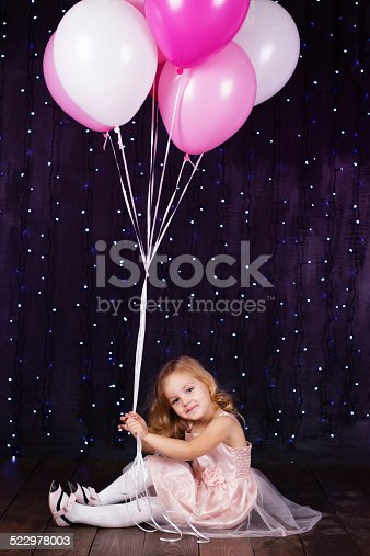 502281614 istock photo Little girl with pink balloons 522978003