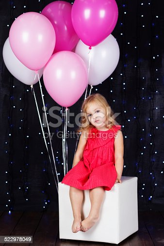 502281614 istock photo Little girl with pink balloons 522978049