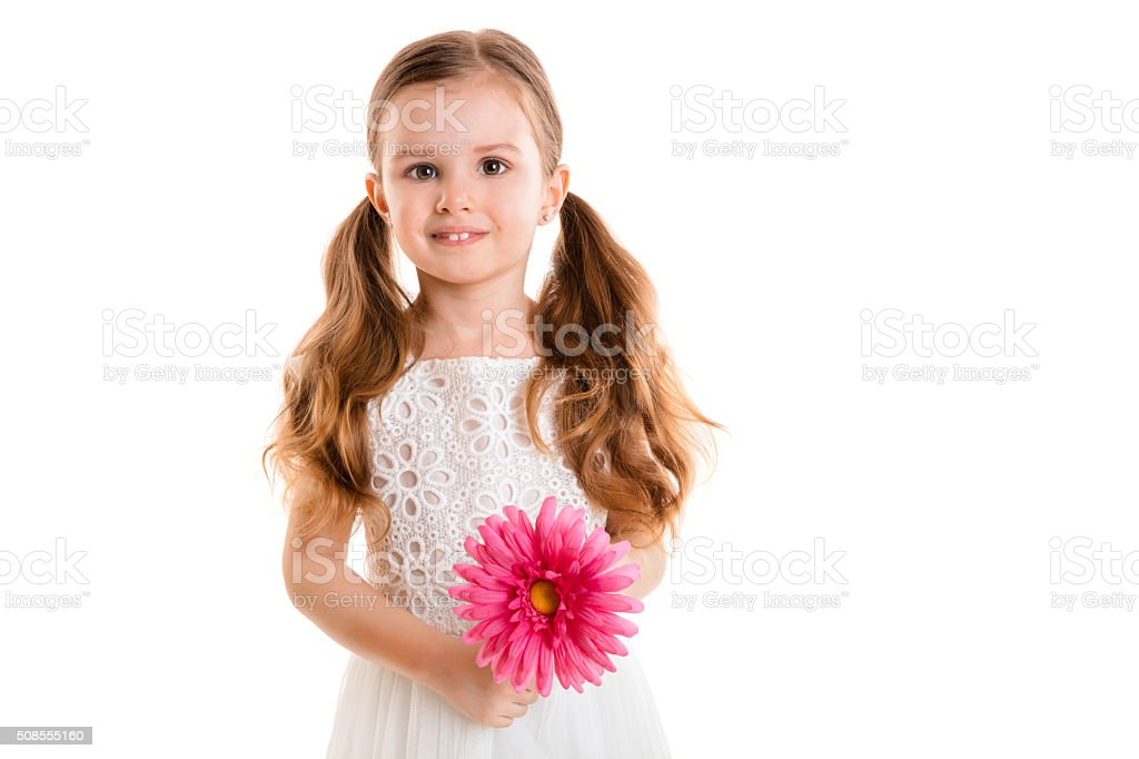 little girl with pink flower (isolated on white background, isolated) stock photo