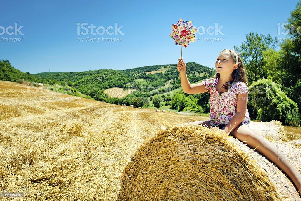 Little girl with pinwheel royalty-free stock photo