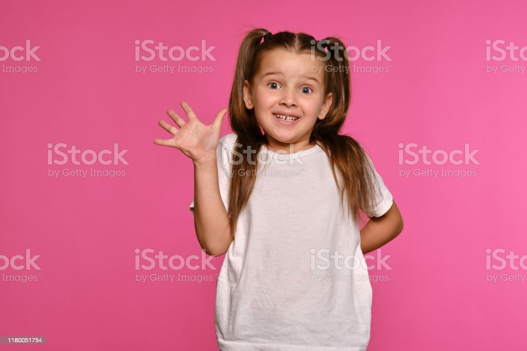 Swell Little Girl With Ponytails Dressed In White Tshirt Is Posing Natural Hairstyles Runnerswayorg