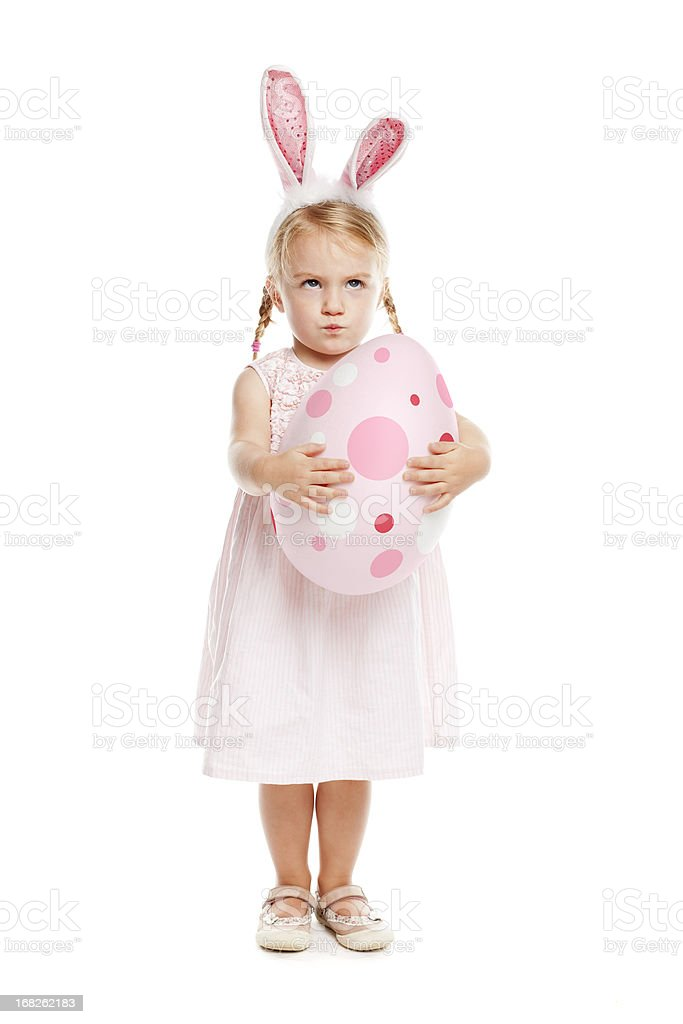 Little girl with rabbit ears and easter egg stock photo