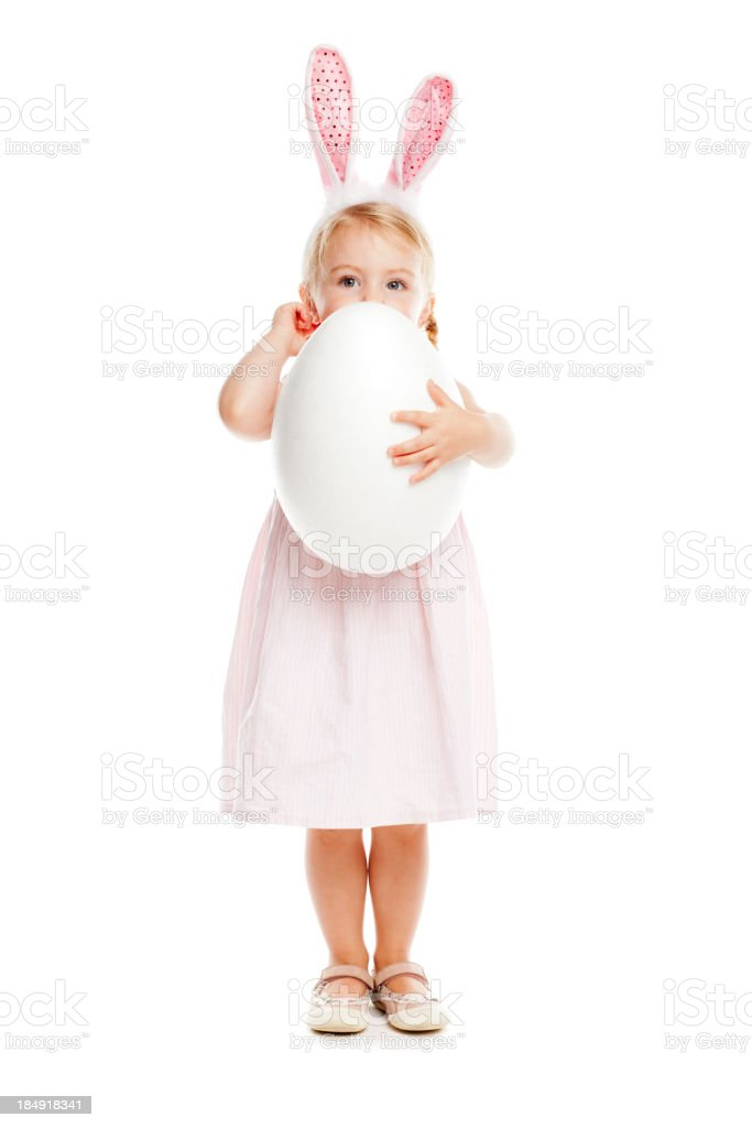Little girl with rabbit ears and easter egg royalty-free stock photo