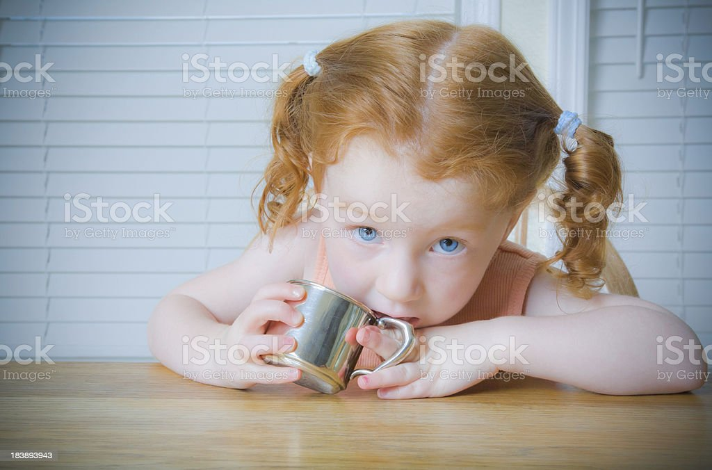Little Girl With Red Hair Blue Eyes And Silver Cup Stock Photo