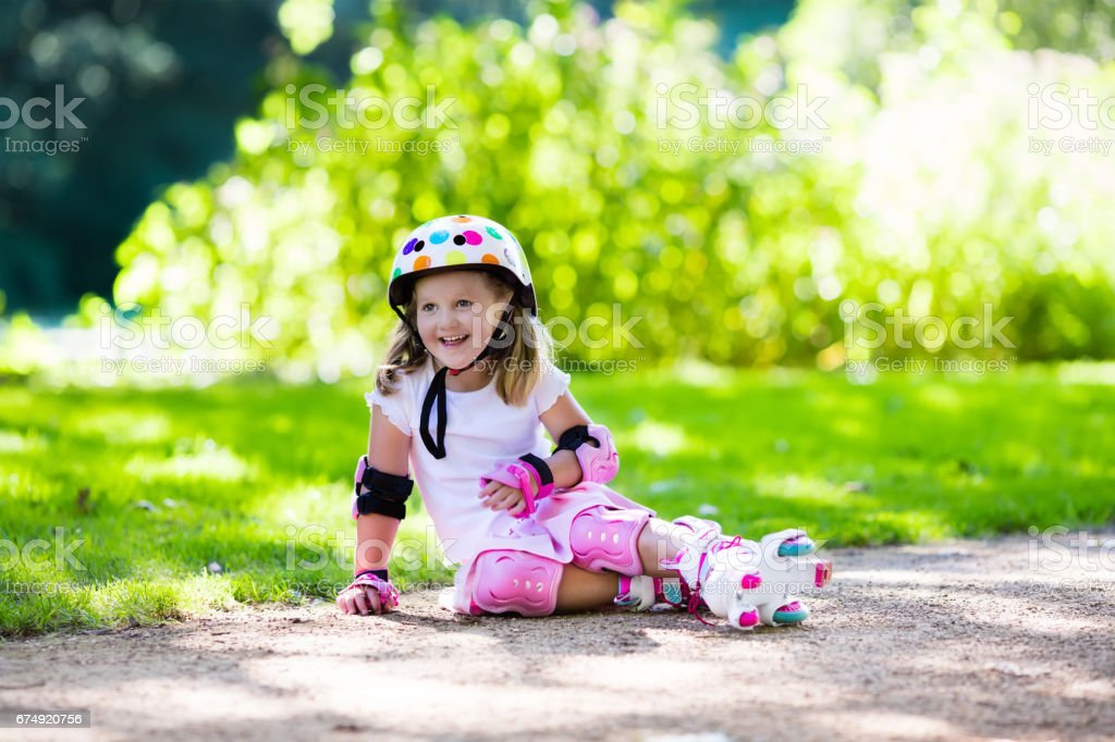 Little girl with roller skate shoes in a park royalty-free stock photo