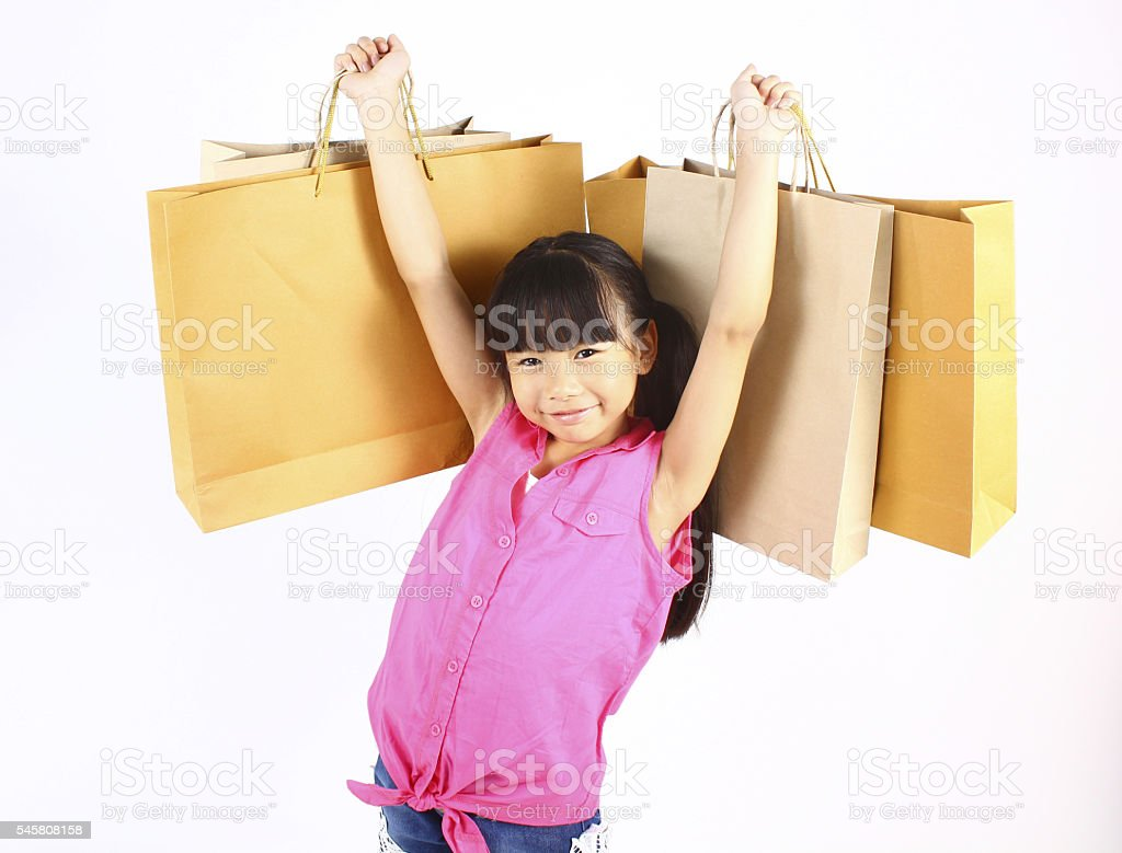 Little girl with shopping bags stock photo